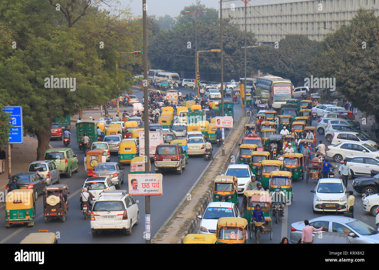 People commute in downtown New Delhi India - Stock Image