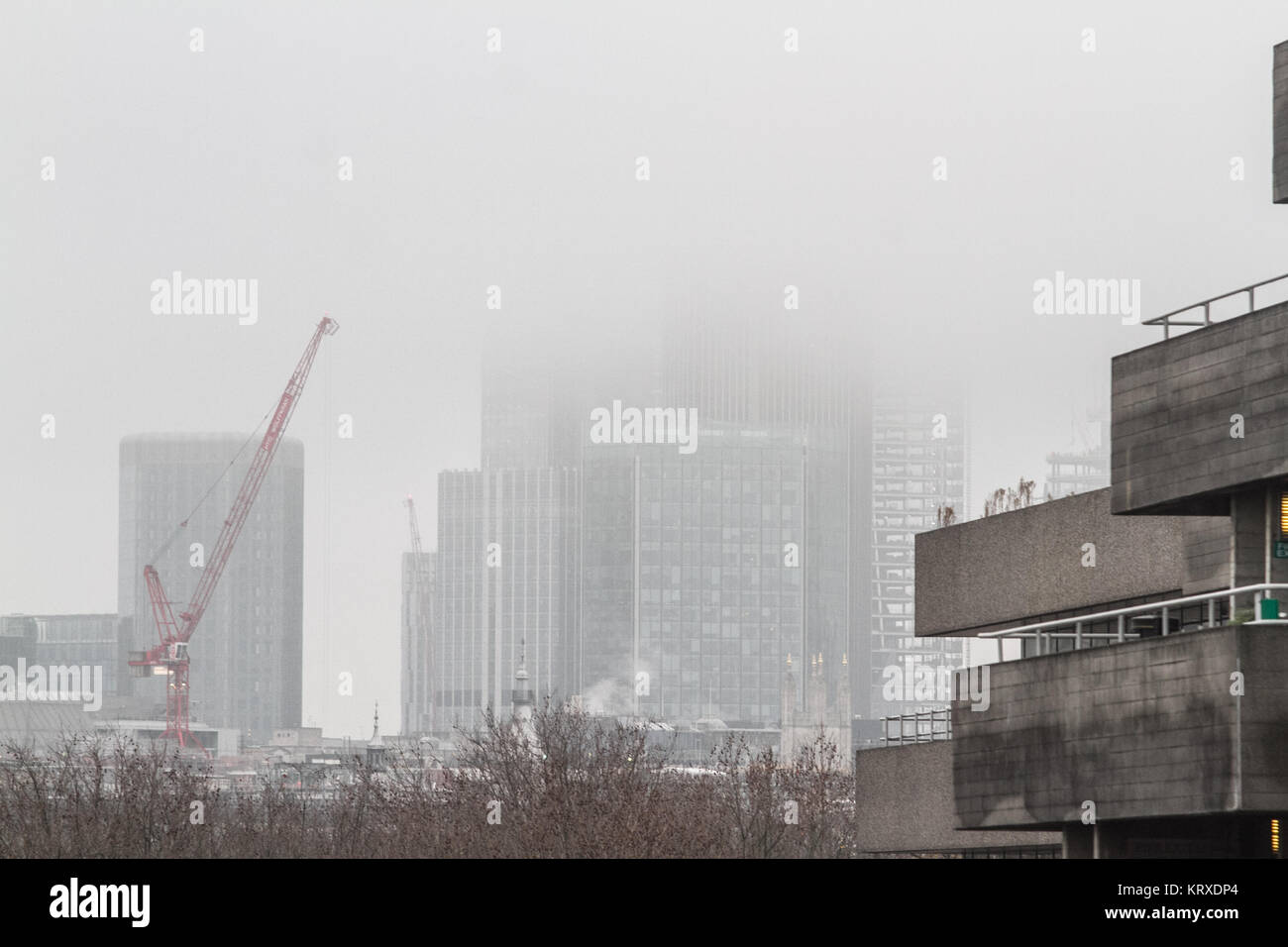 London UK. 21st December  2017. The skyline of the city of London financial district and buildings are shrouded Stock Photo