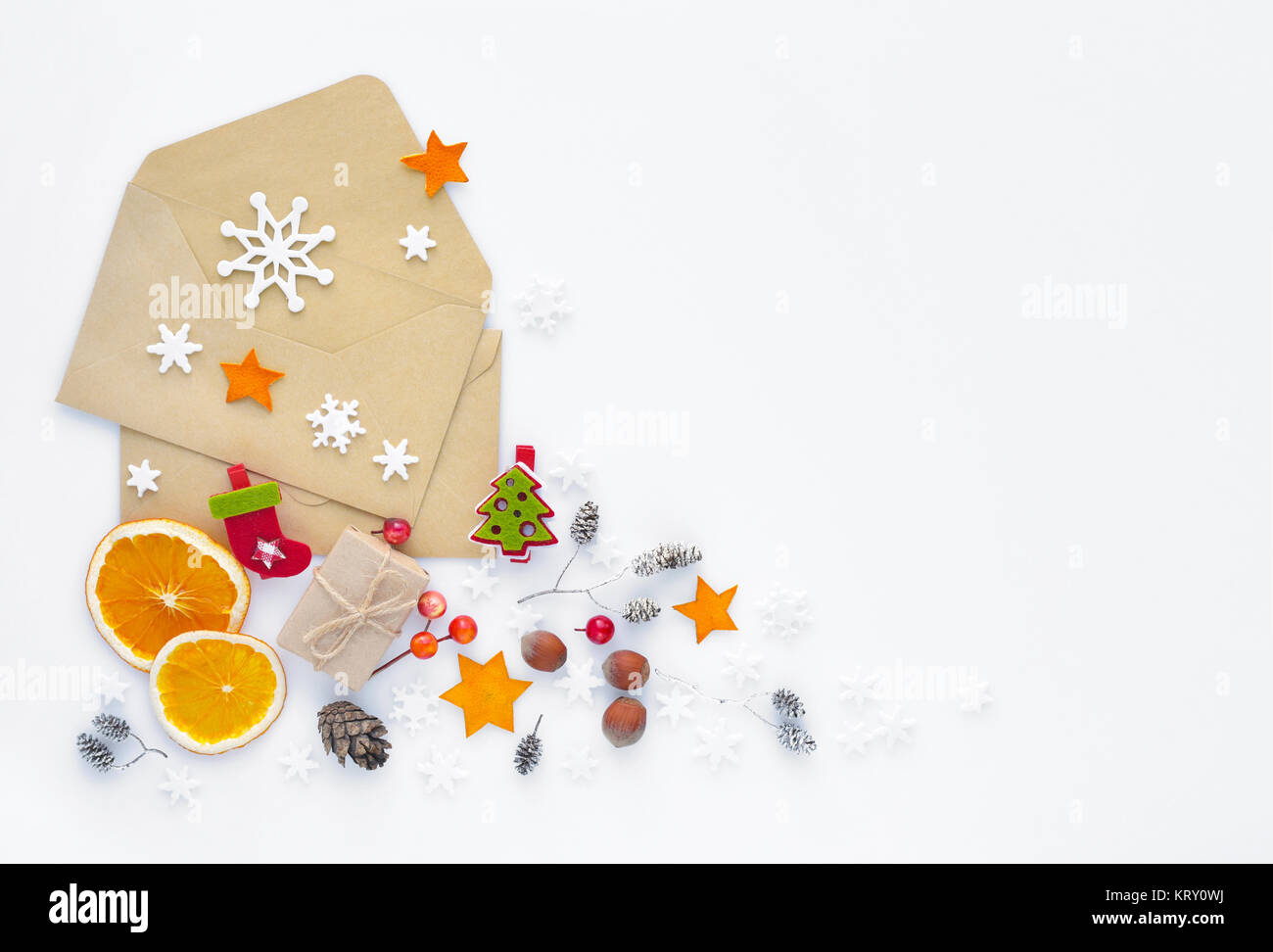 Christmas, happy new year composition. Christmas gifts, envelopes, christmas decorations, snowflakes on white background. Stock Photo