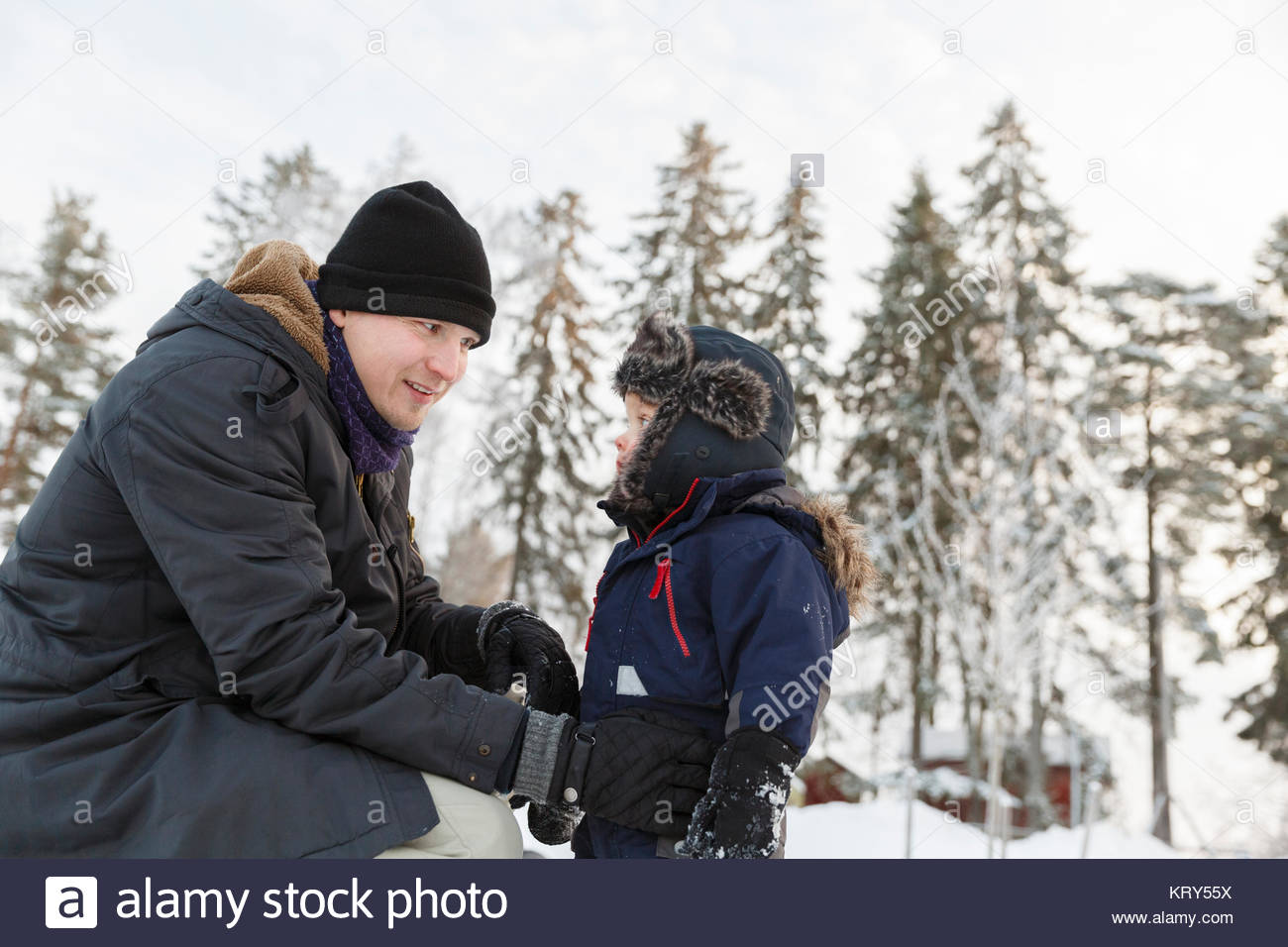 Father and son wearing hats during winter - Stock Image