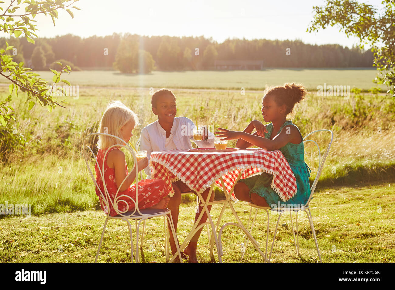 Children at a table outside - Stock Image
