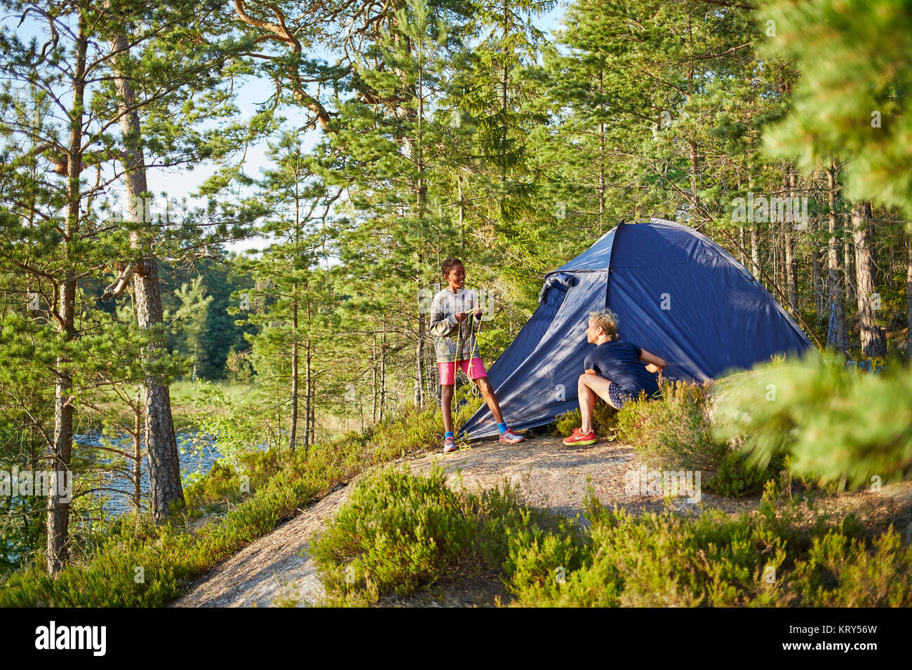 Boy and woman camping - Stock Image