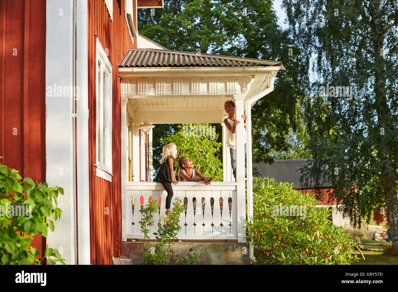 Children playing on portico - Stock Image