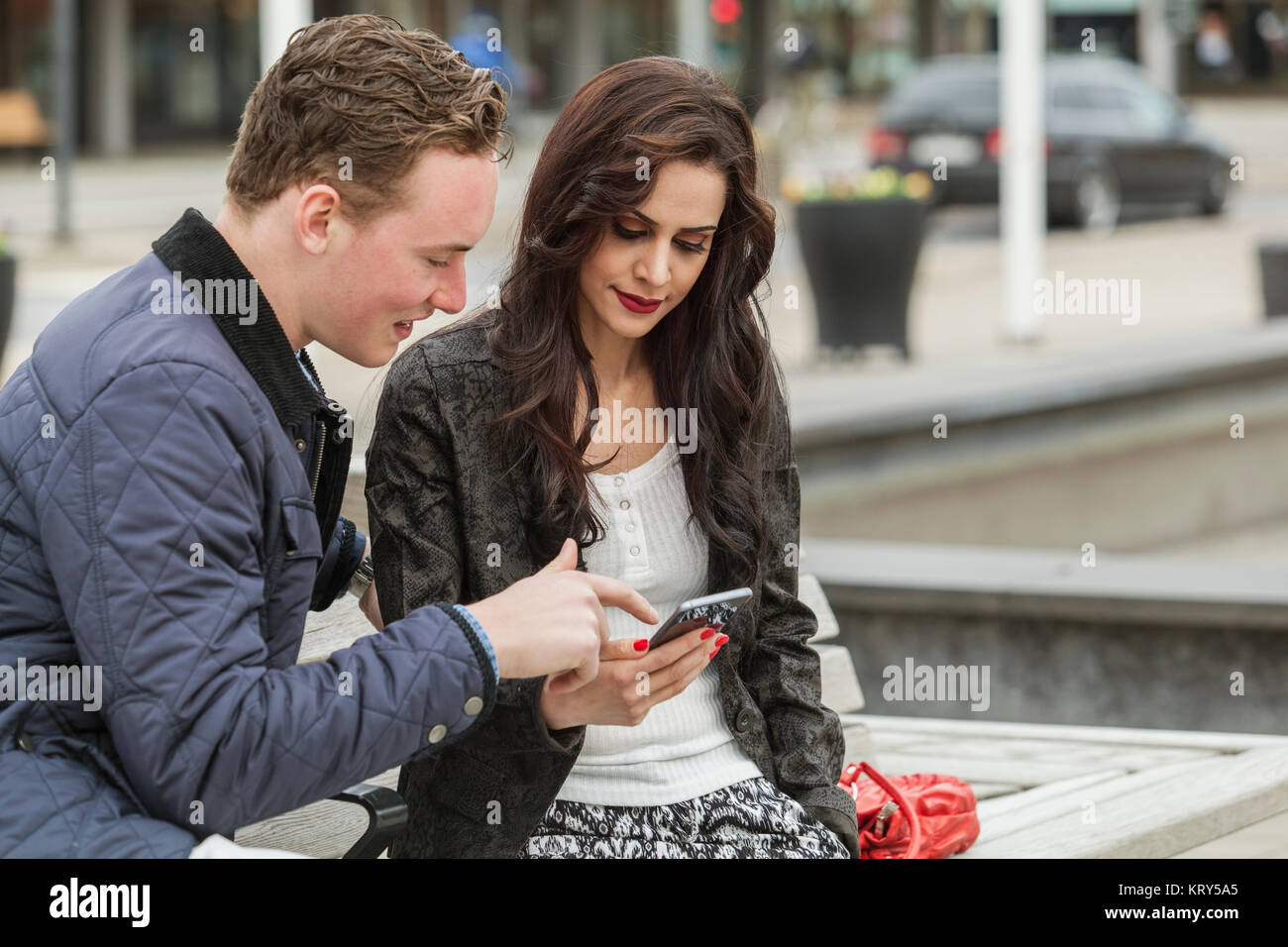 Couple looking at a smart phone in Blekinge, Sweden - Stock Image