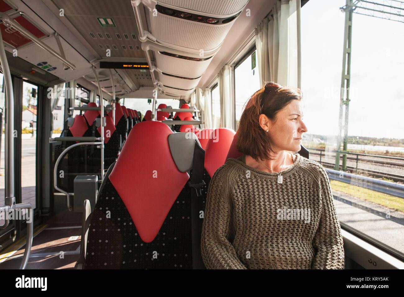 Woman sitting on a train Stock Photo