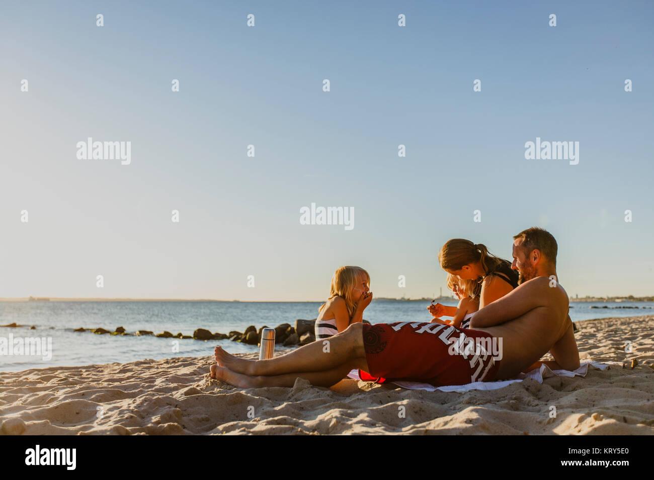 A family on the beach Stock Photo