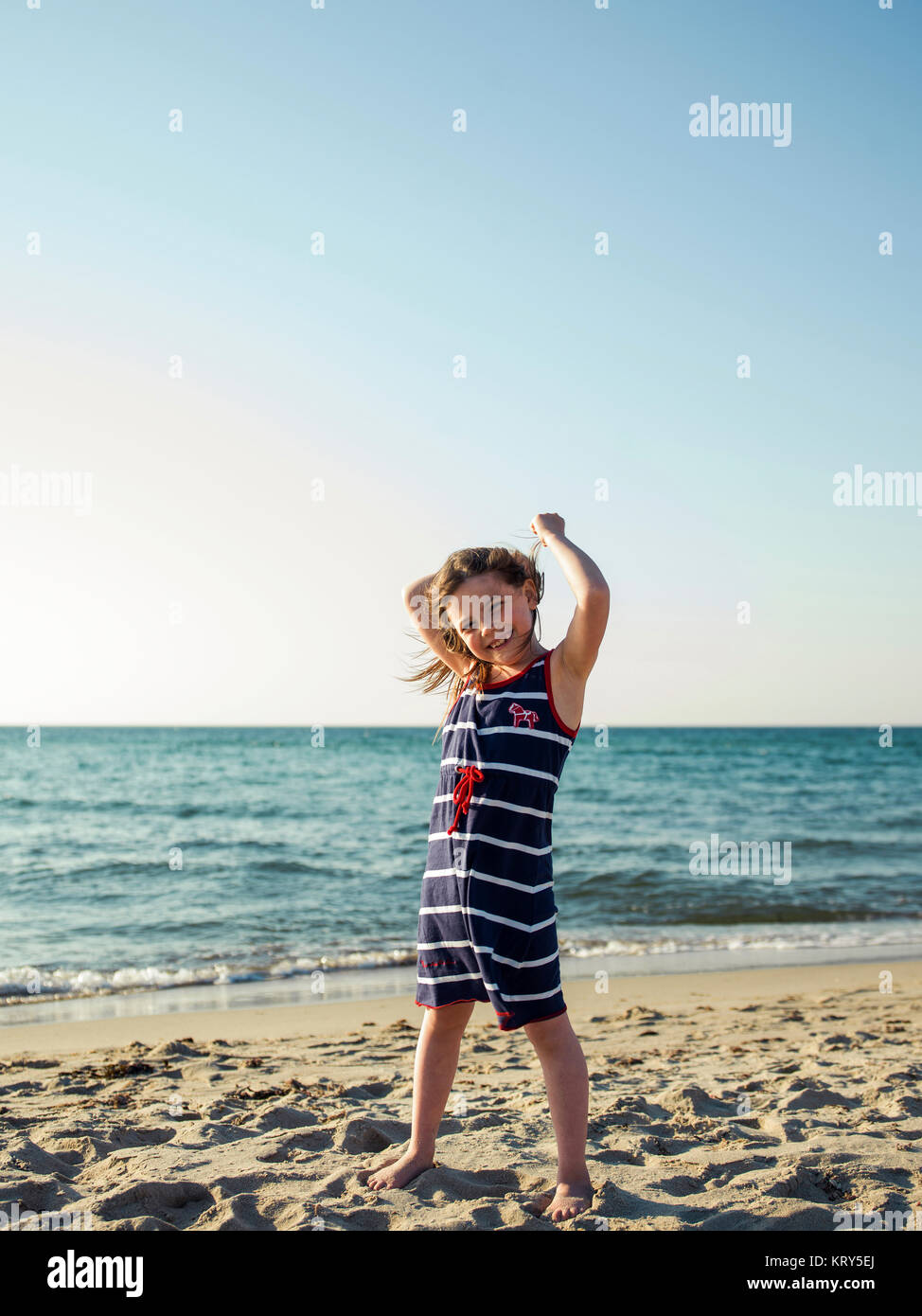 A young girl at the beach - Stock Image