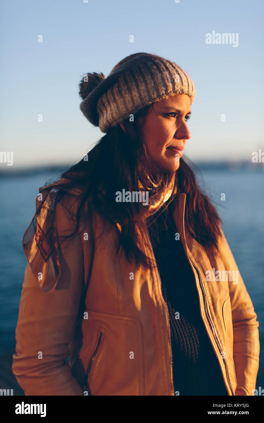 Woman wearing grey beanie - Stock Image