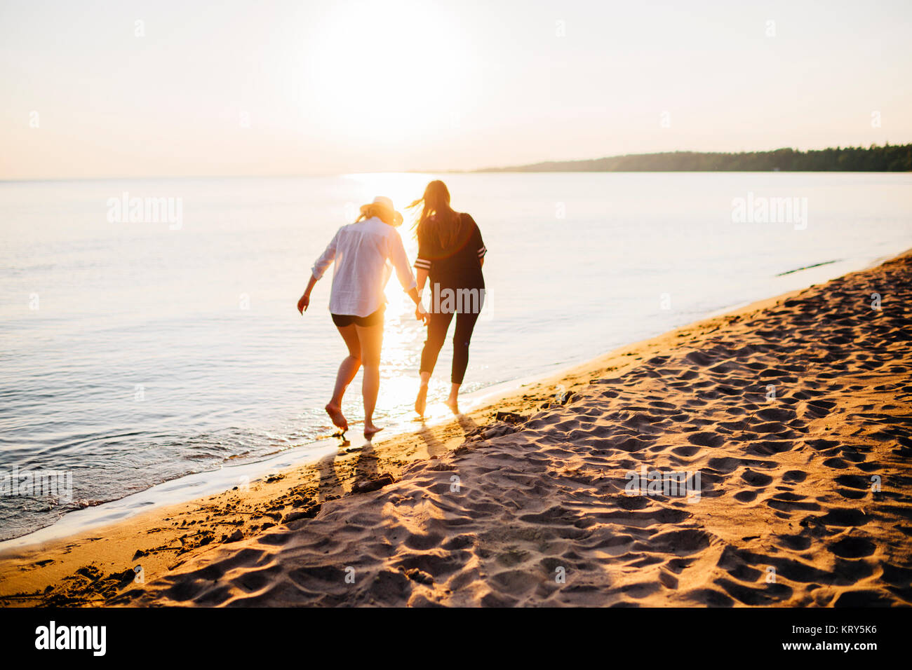 Two women on the beach - Stock Image