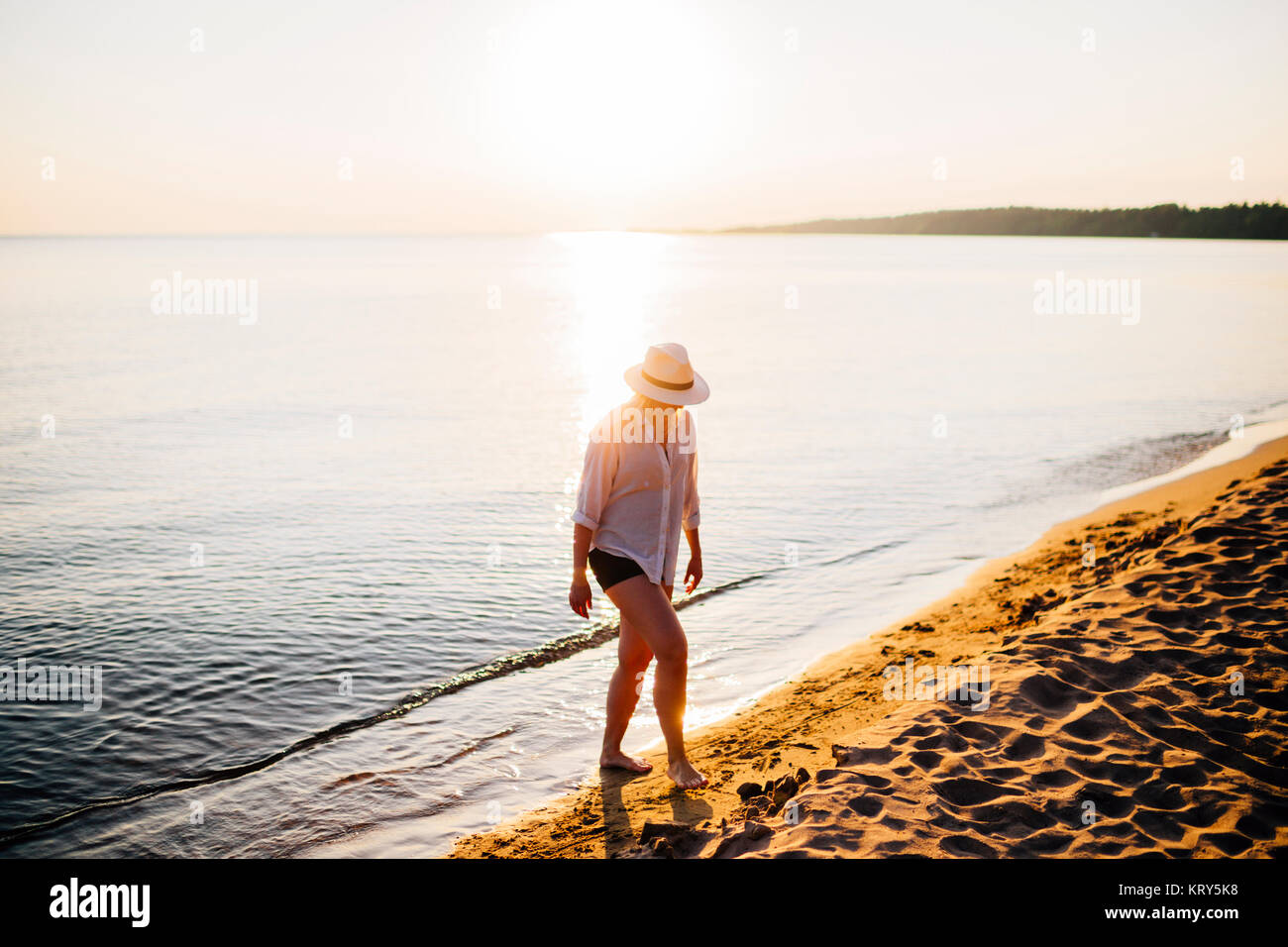 A woman on the beach - Stock Image