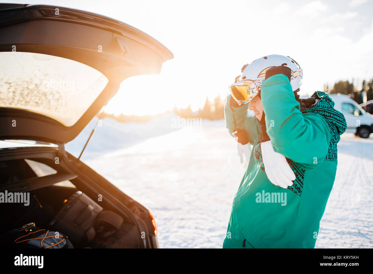 Man by a car on snow in Osterdalen, Norway Stock Photo