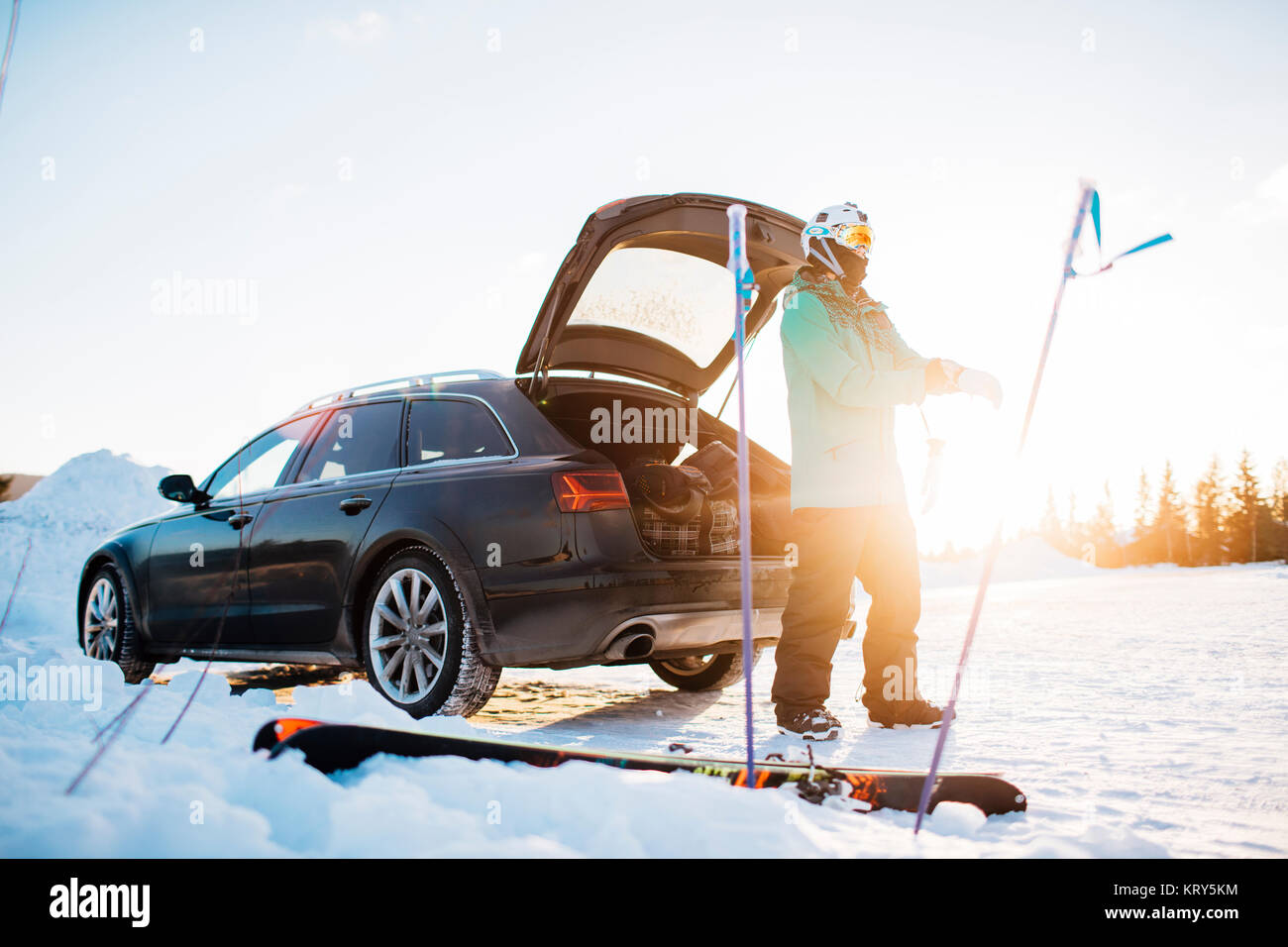 Man by a car with skiing equipment in Osterdalen, Norway - Stock Image