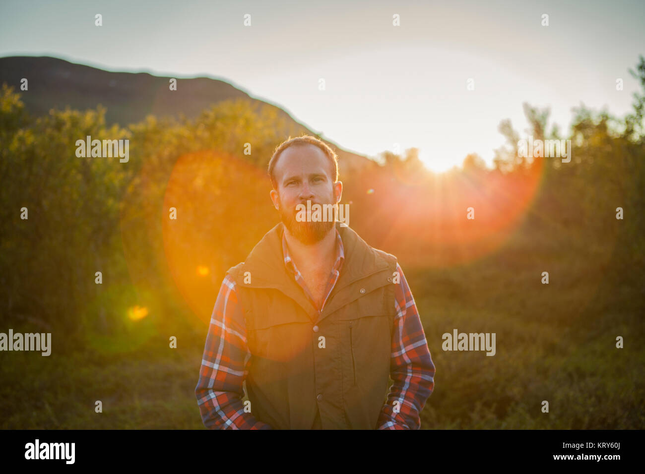 A man outdoors in the Swedish countryside - Stock Image