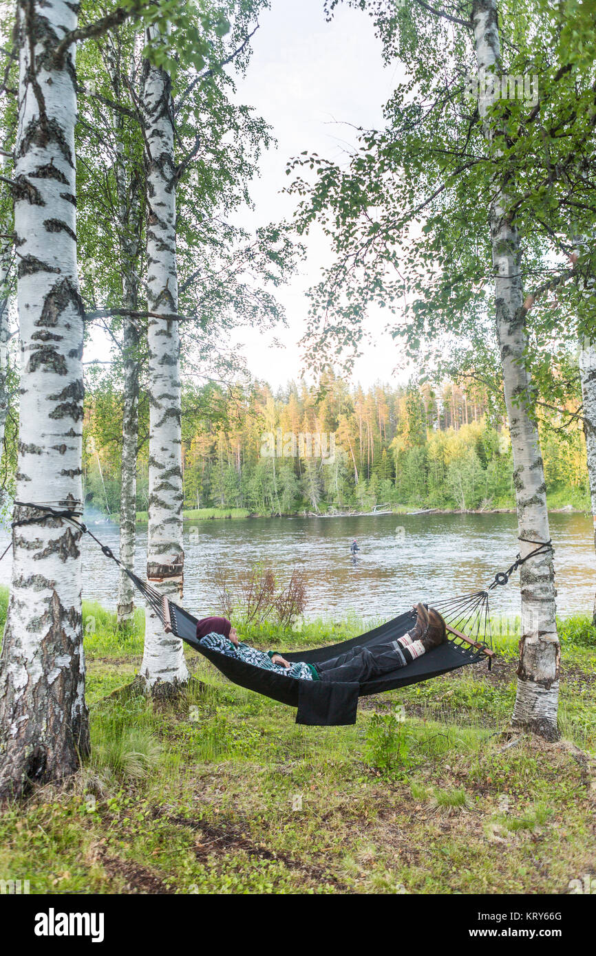 Woman lying on hammock - Stock Image