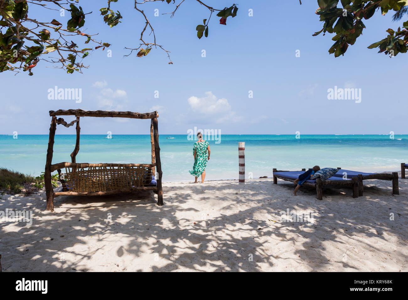 Woman standing on Diani Beach, Kenya - Stock Image