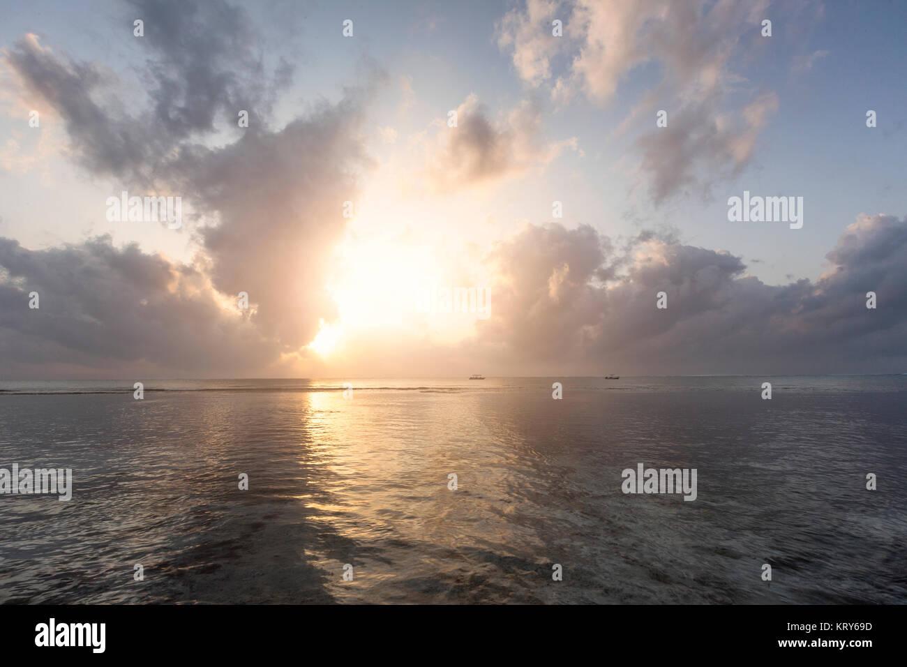 Sunset over sea at Diani Beach, Kenya - Stock Image