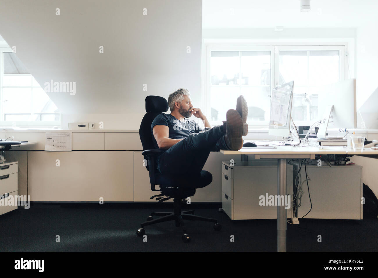 Man at an office desk - Stock Image