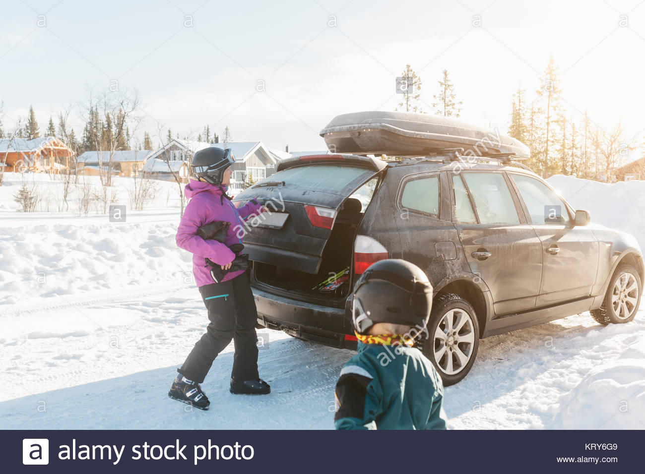 Mother and son by a car during winter Stock Photo
