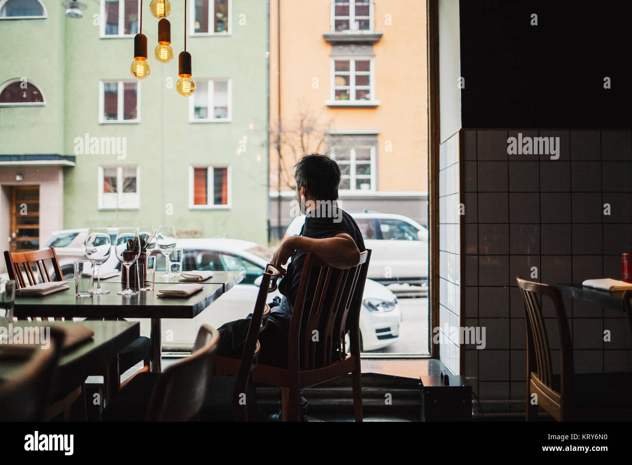 Chef sitting in a restaurant Stock Photo