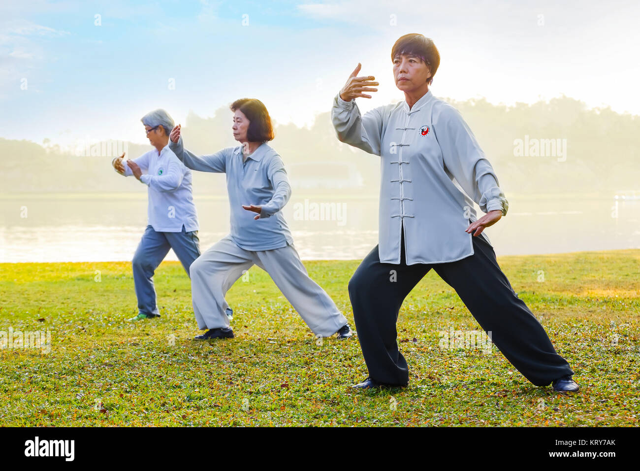BANGKOK, THAILAND - FEBRUARY 13, 2016: Unidentified group of people practice Tai Chi Chuan in a park - Stock Image