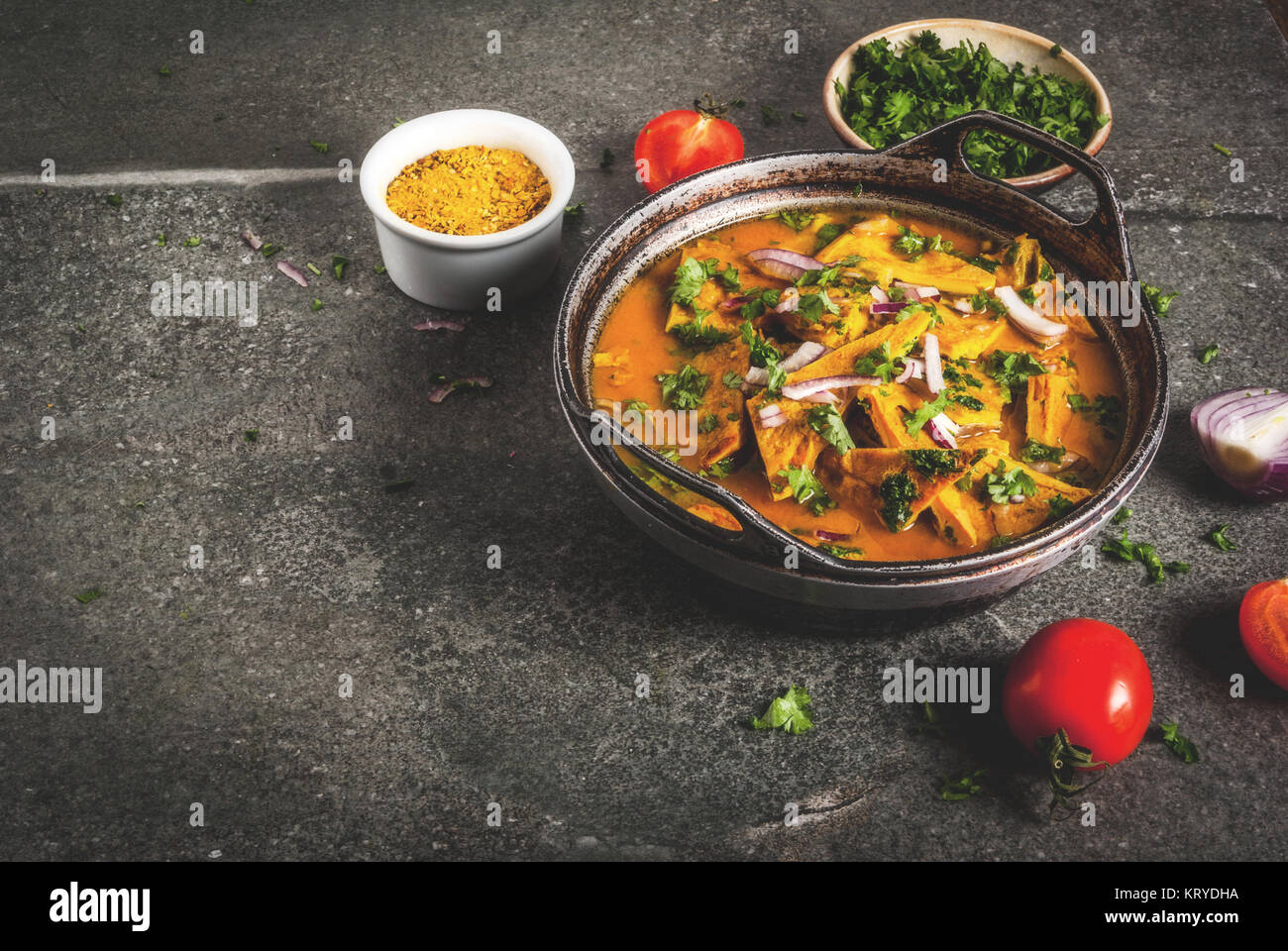 Indian food recipes, Indian Omelet Masala Egg Curry, with fresh vegetables - tomato, hot chili pepper, parsley dark - Stock Image