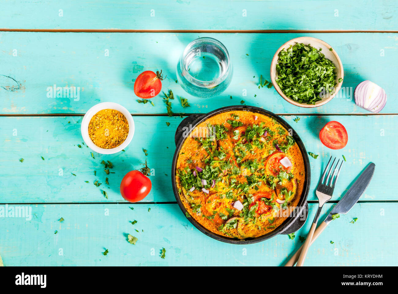 Indian food recipes indian masala egg omelet with fresh vegetables indian food recipes indian masala egg omelet with fresh vegetables tomato hot chili pepper parsley light blue wooden background copy space top forumfinder Gallery