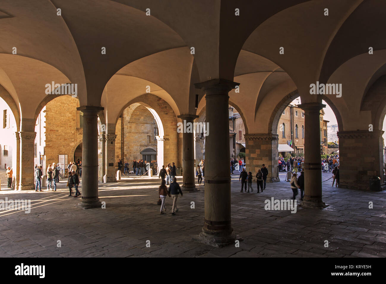 The ancient medieval arcade of Bergamo, upper city - Stock Image