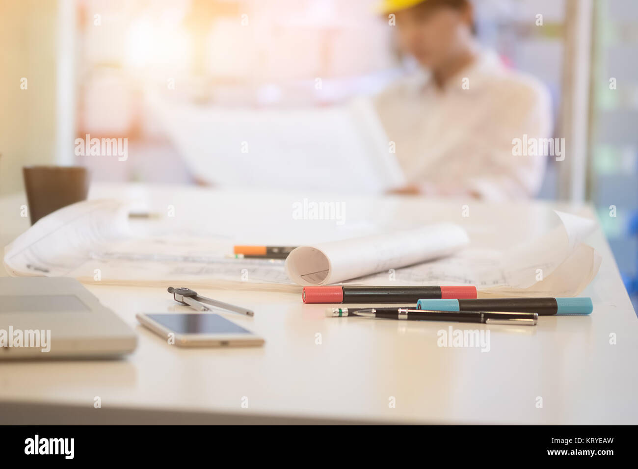 Architectural blueprints and objet of architect on working table. - Stock Image