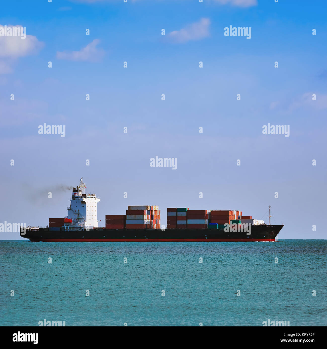 Container Ship in the Sea - Stock Image