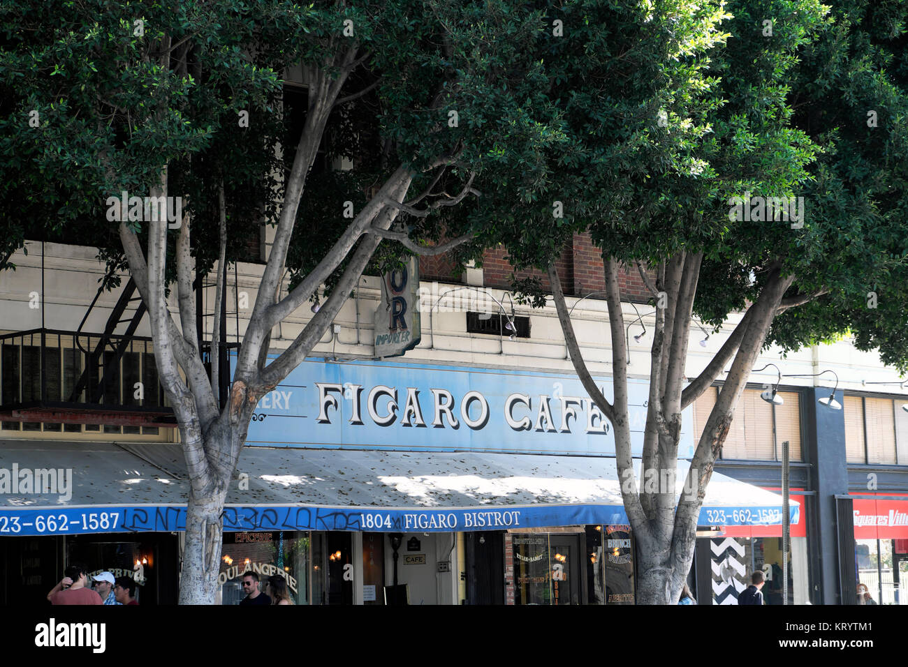 Exterior view of Figaro Cafe sign with trees on Vermont Avenue in Los Feliz neighbourhood of Los Angeles, California - Stock Image