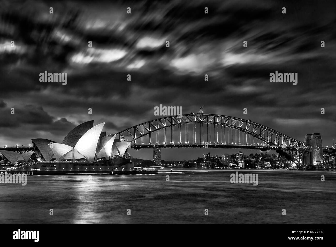 Sydney, Australia, 18 March 2017: World famous Sydney Opera House and Harbour bridge at sunset. Blurred clouds and Stock Photo