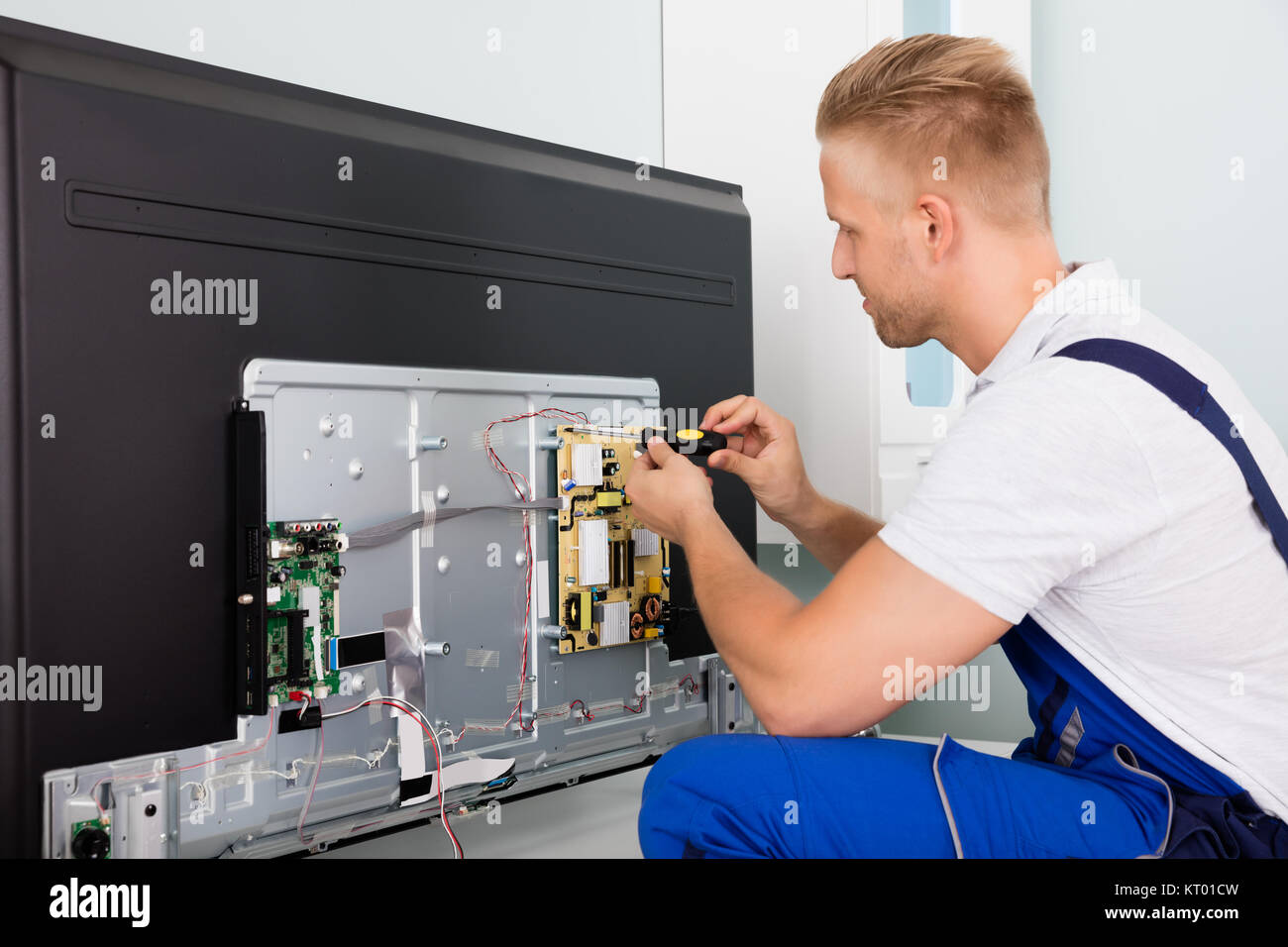 Electrician Checking Television - Stock Image