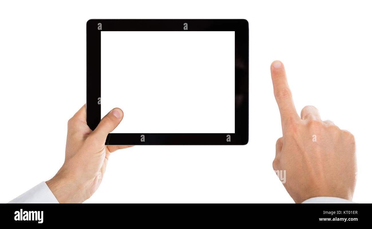Person Hand Holding Digital Tablet - Stock Image