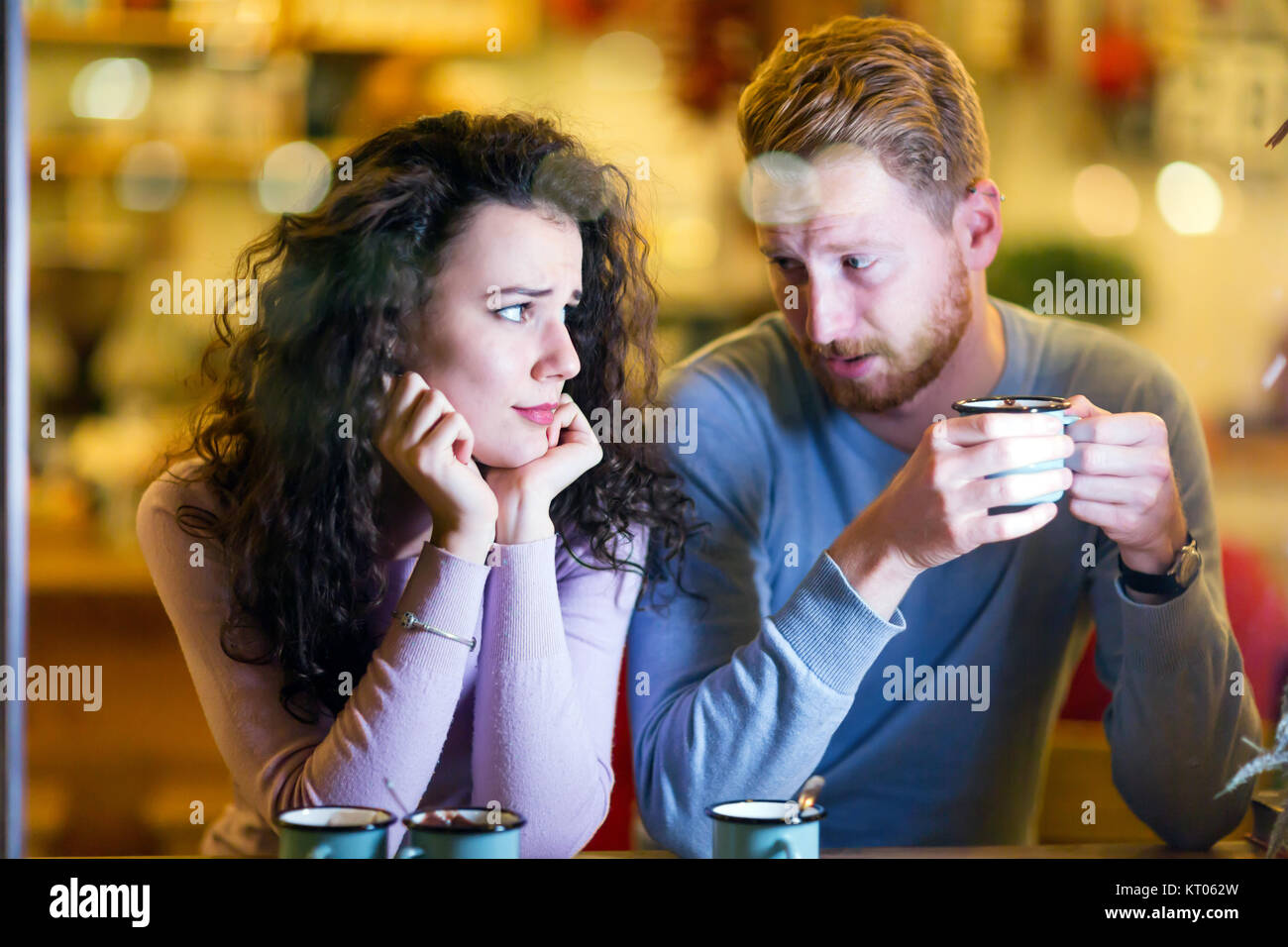 Young attractive couple having problems on date - Stock Image