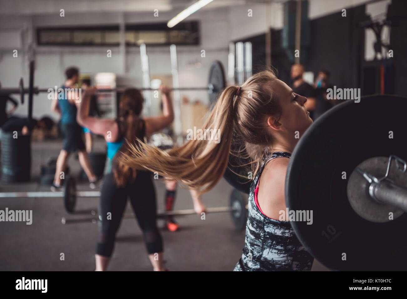 Women and fitness training. Weightlifting, working out and cross training. - Stock Image