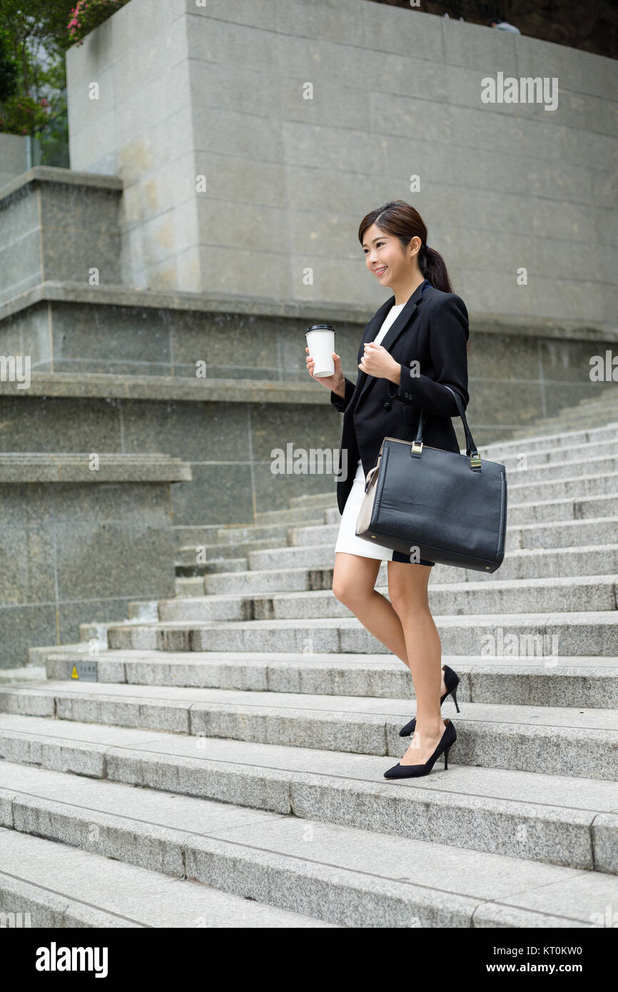 Businesswoman leaving office - Stock Image