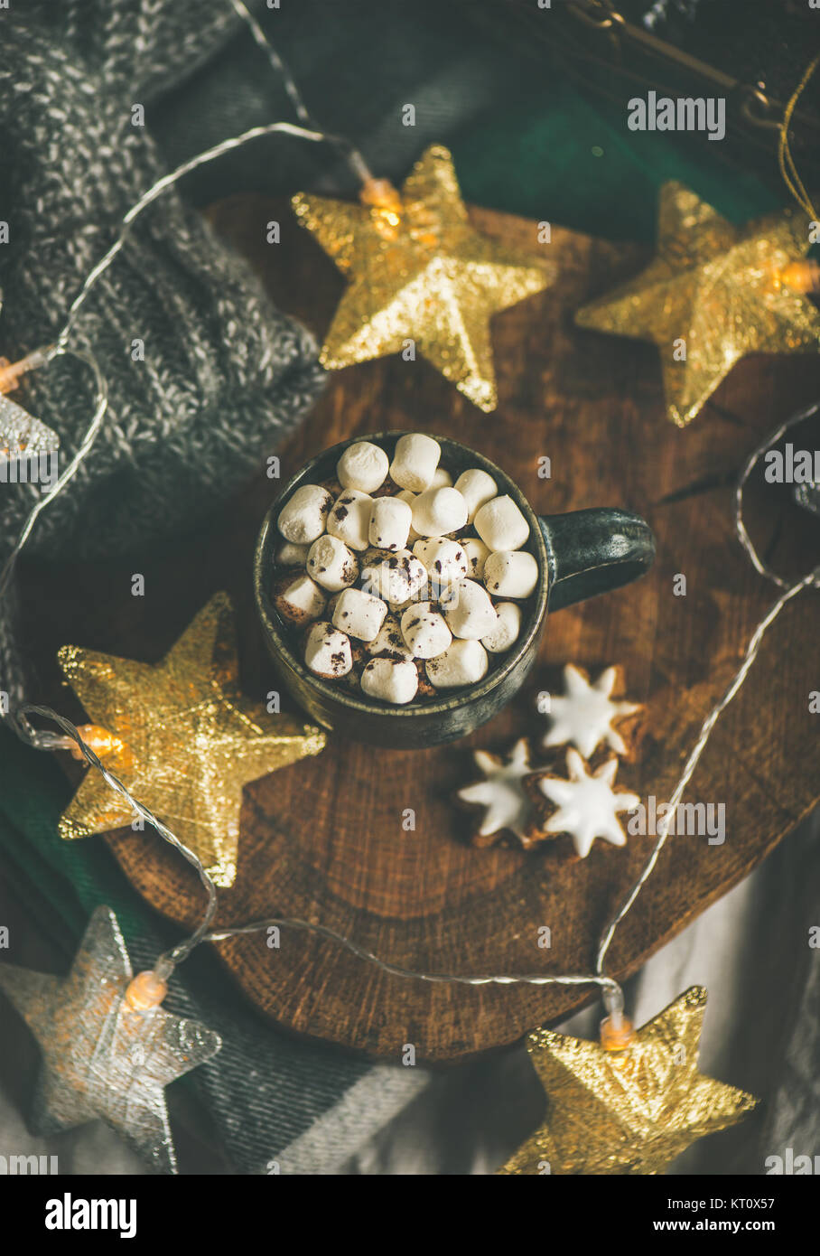 Christmas or New Year winter hot chocolate with marshmallows and gingerbread cookies over rustic wooden board served - Stock Image