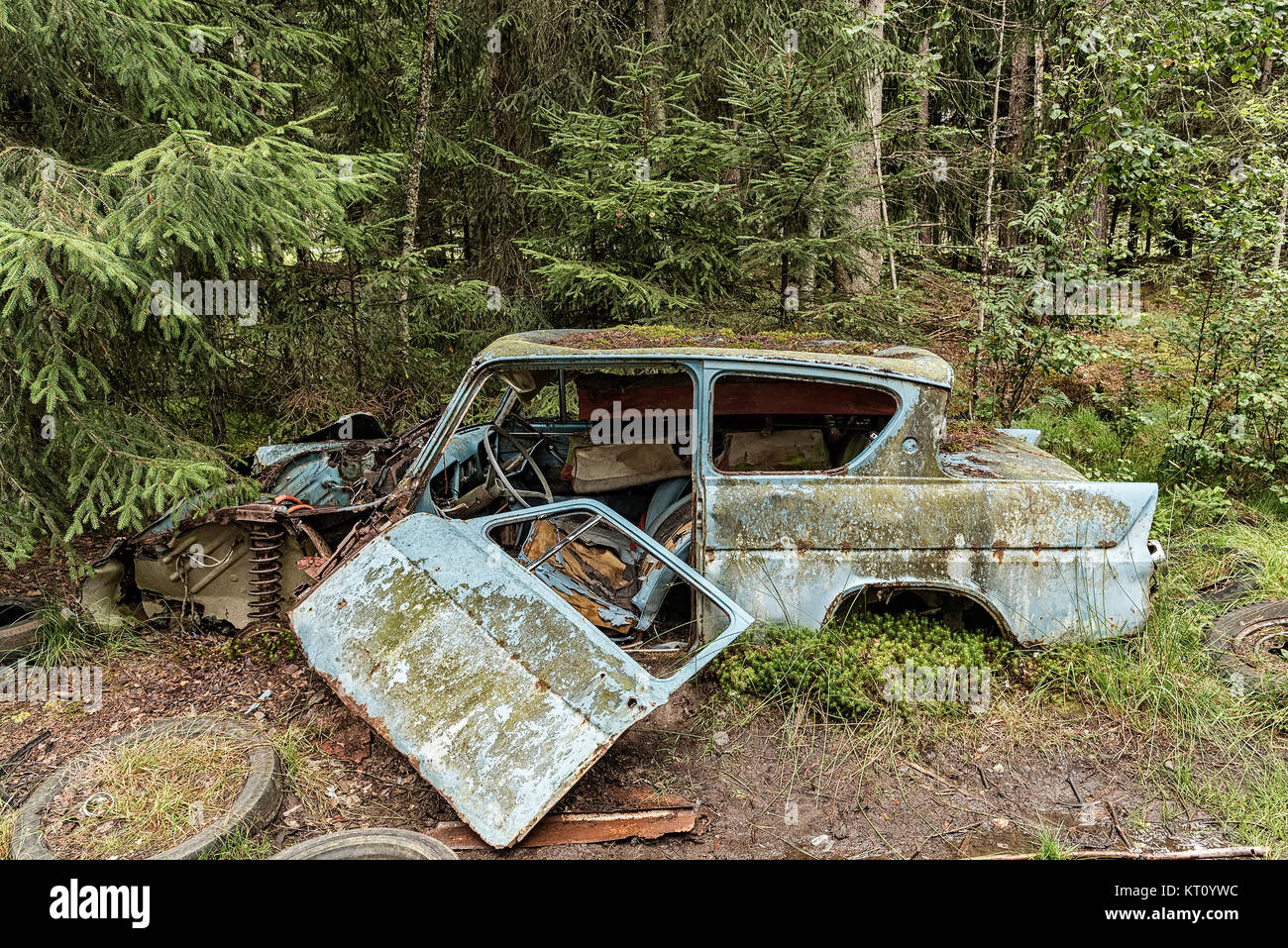 KIRKOE MOSSE, SWEDEN - 28 JULY 2016: A car graveyard situated in a forest at Kirkoe Mosse, Sweden. - Stock Image