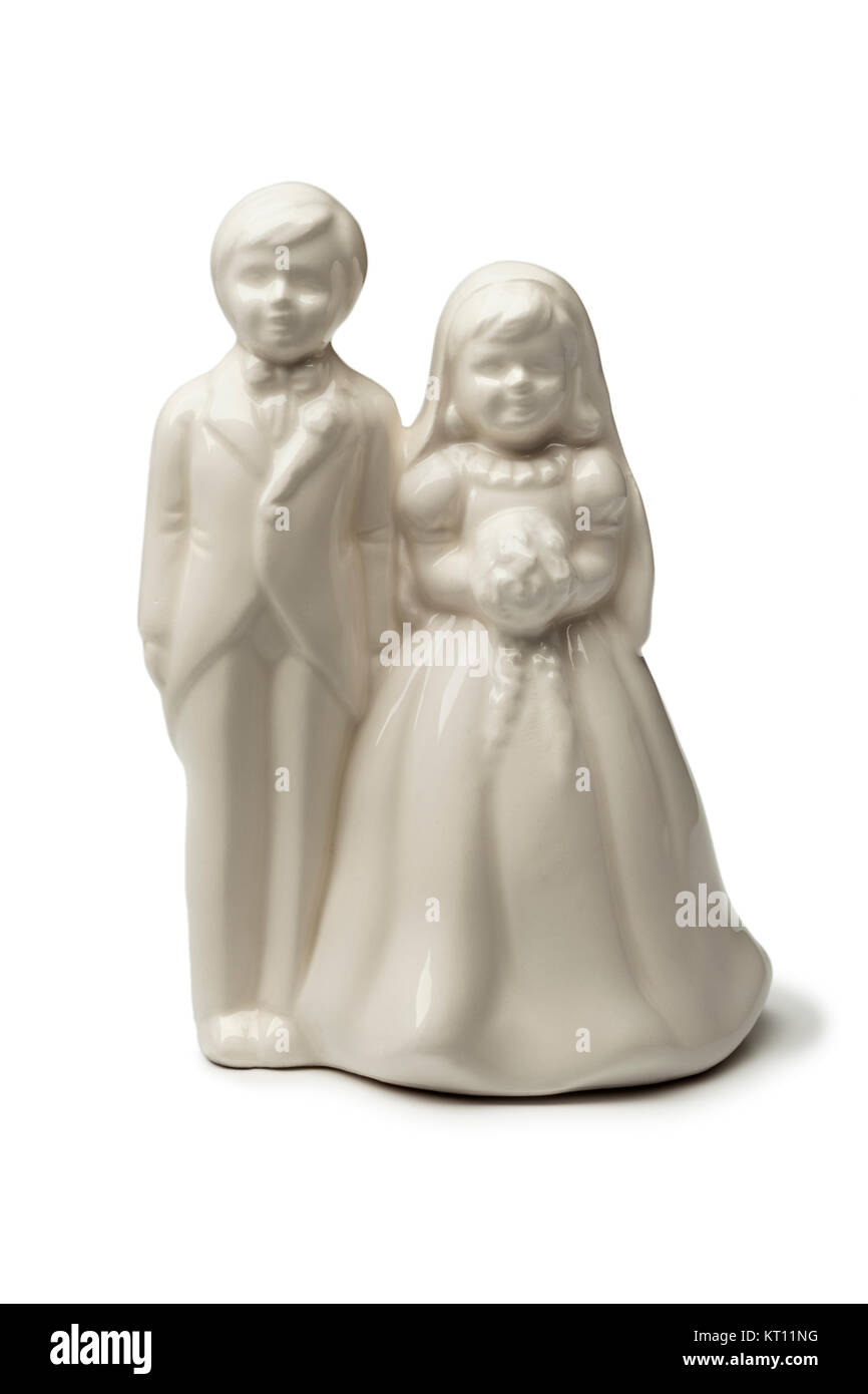 White Bride and groom porcelain figurine on white background - Stock Image