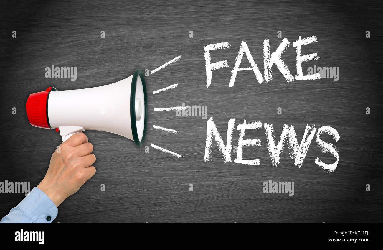 fake news - megafone with hand - Stock Image