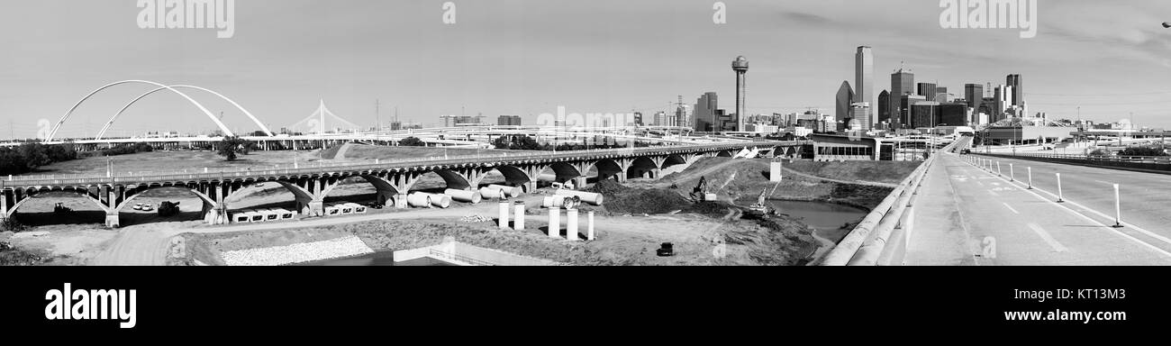 Bridges traverse the river and lead commuters into Dallas Texas - Stock Image