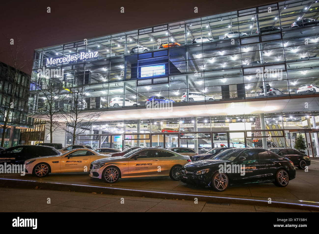 MUNICH, GERMANY - DECEMBER 11, 2017 : Exhibited cars parked in front of the Mercedes Benz dealership building at Stock Photo