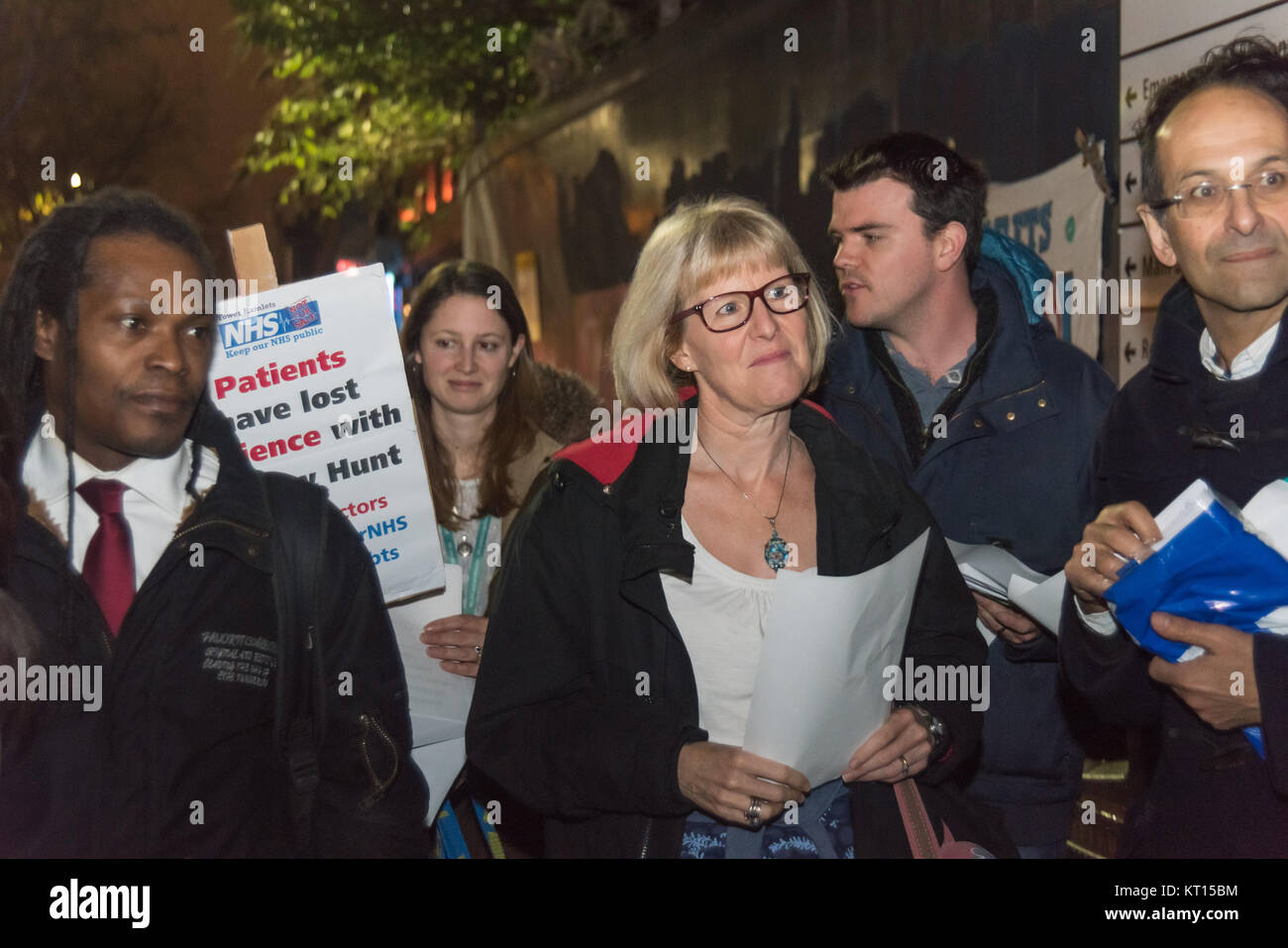 People lister to speeches at the Christmas protest outside old Royal London Hospital supporting Junior Doctors & - Stock Image