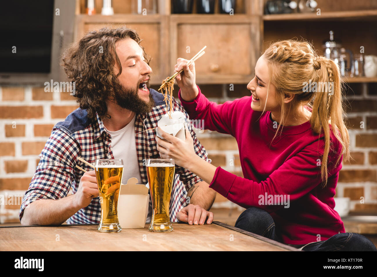 Couple eating noodles - Stock Image