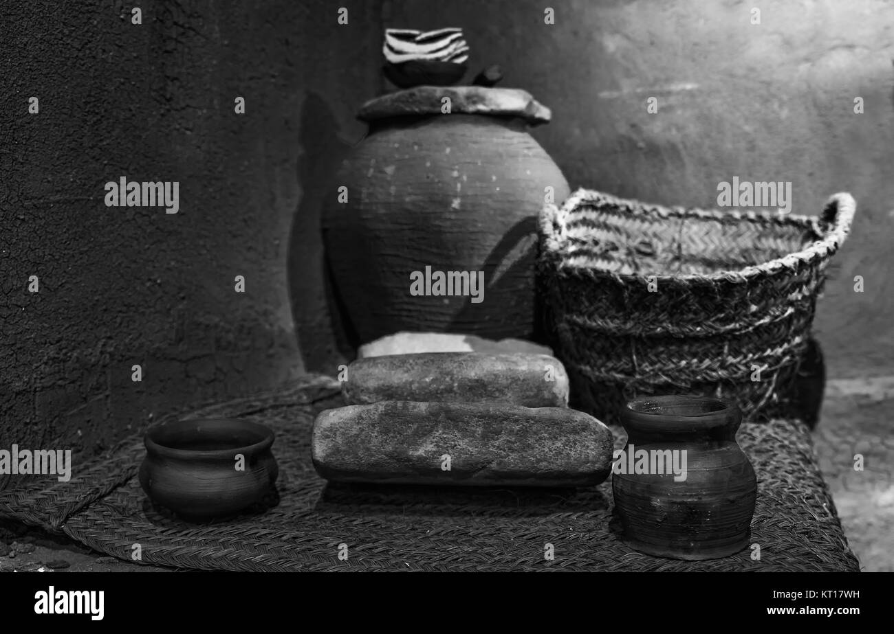 Set of ancient pots and containers in mud and reeds. - Stock Image