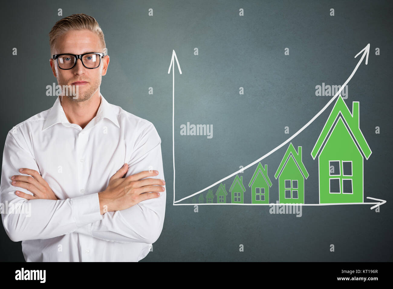 Confident Man With Growing Real Estate Graph - Stock Image