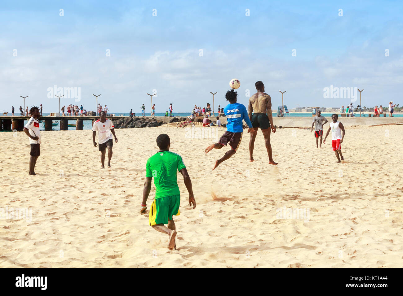 Locals playing football on the beach at Santa Maria, Sal Island, Salina, Cape Verde, Africa - Stock Image