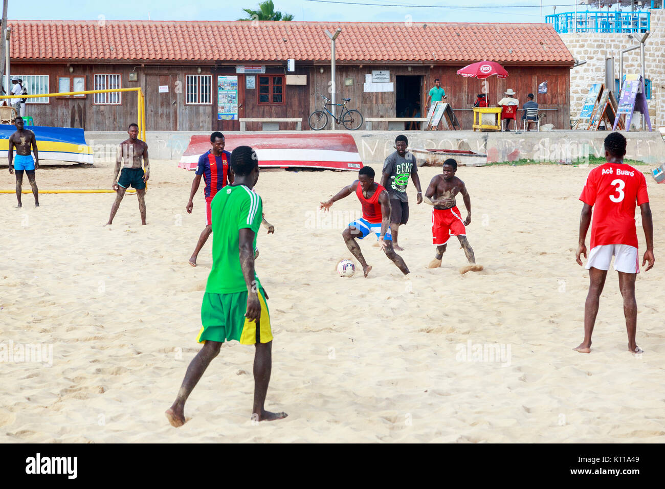 Local men playing football on the beach at Santa Maria, Sal Island, Salina, Cape Verde, Africa - Stock Image