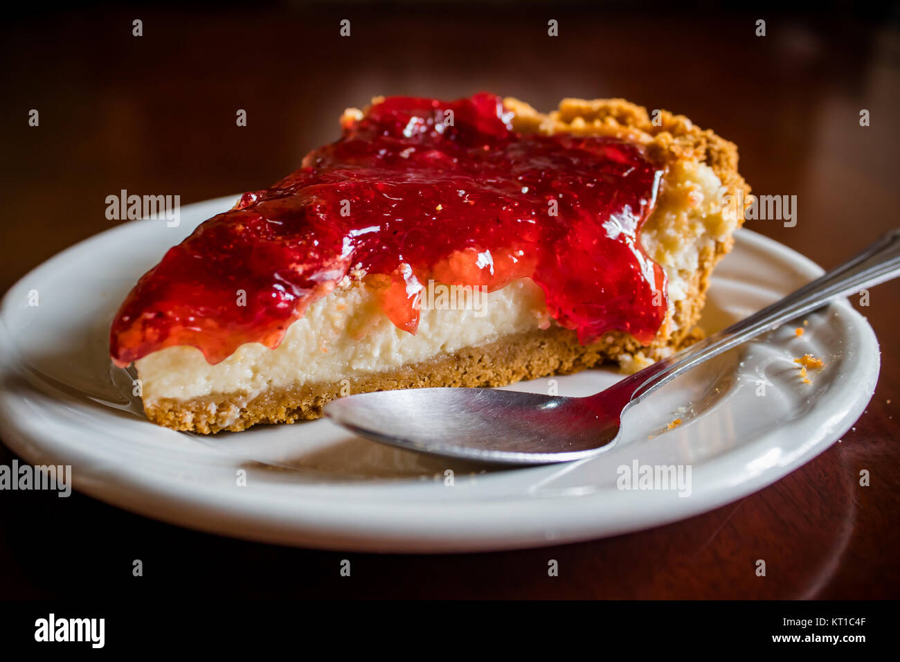 A delicious piece of cheesecake - Stock Image