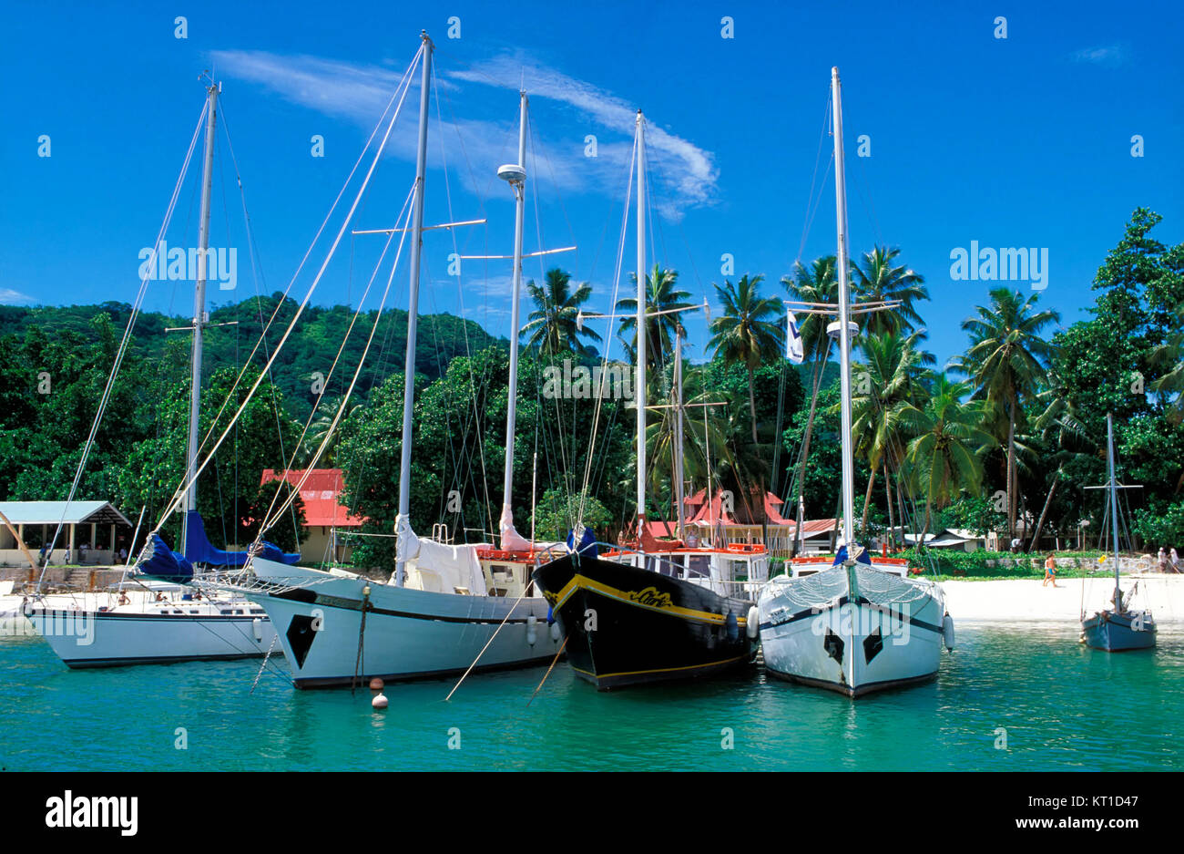 Sailing ships in the harbor, La Digue island, Seychelles - Stock Image